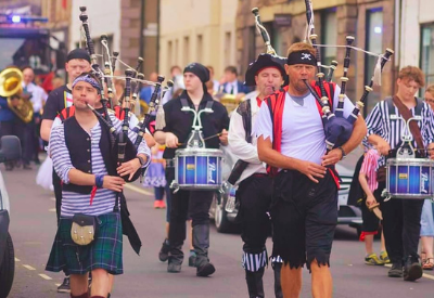 image shows a pipe band dressed as pirates on gala day
