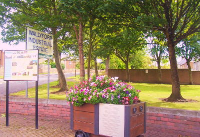 image show improvements made in Wallyford with flowers and an information board