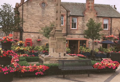 Image shows a wonderful display of bright, mainly pink, flowers in Tranent.